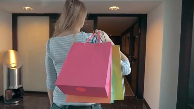 Woman With Shopping Bags: Stock Video