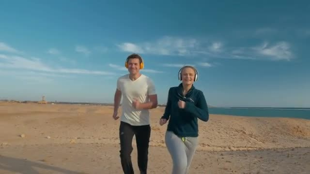Running With Headphones: Stock Video