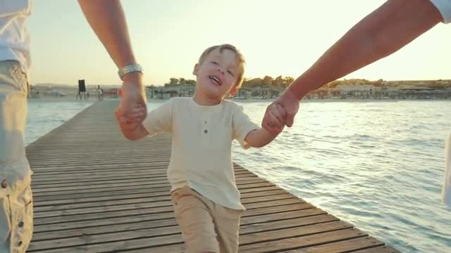 Happy Boy Walking With Grandparents: Stock Video