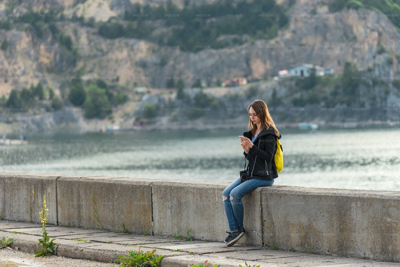 Looking A Smartphone Outdoors: Stock Photos