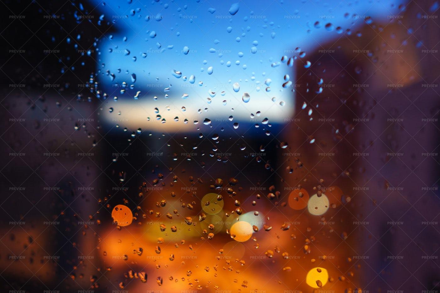 City Trought Wet Window: Stock Photos