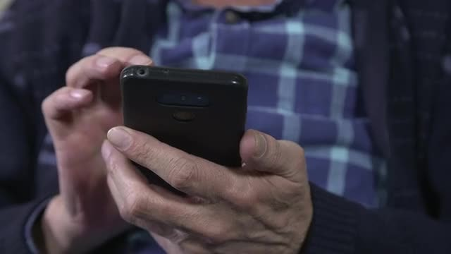 Mature Man Using The Smartphone: Stock Video