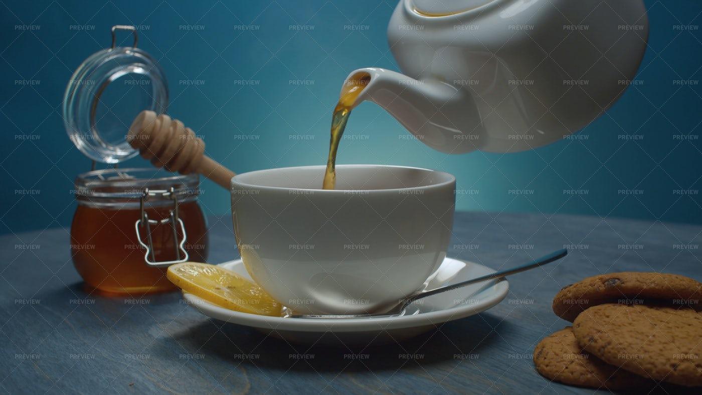 Tea Pouring Into Cup: Stock Photos