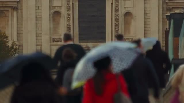 Commuters Walking In The Rain: Stock Video