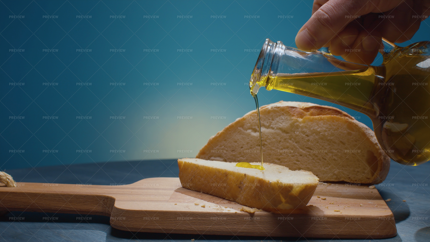 Pouring Olive Oil On Bread: Stock Photos