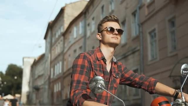Young Handsome Hipster on Motorbike: Stock Video