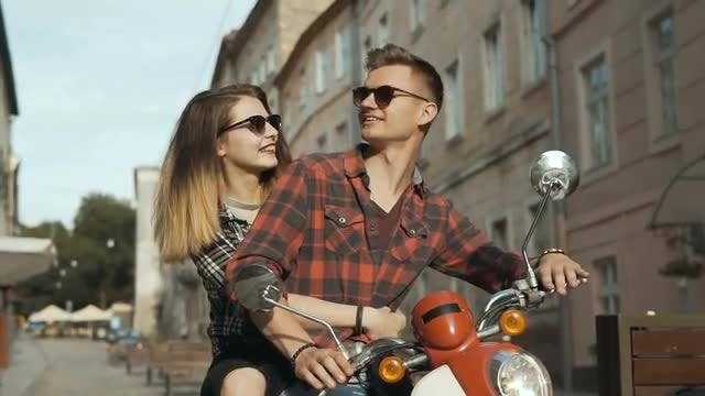 Young Lovers Riding A Motorbike: Stock Video