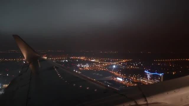 Night Flight Over A Metropolis: Stock Video