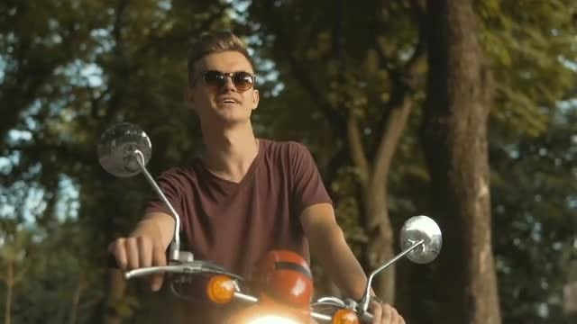 Portrait Of Young Man On Motorbike: Stock Video