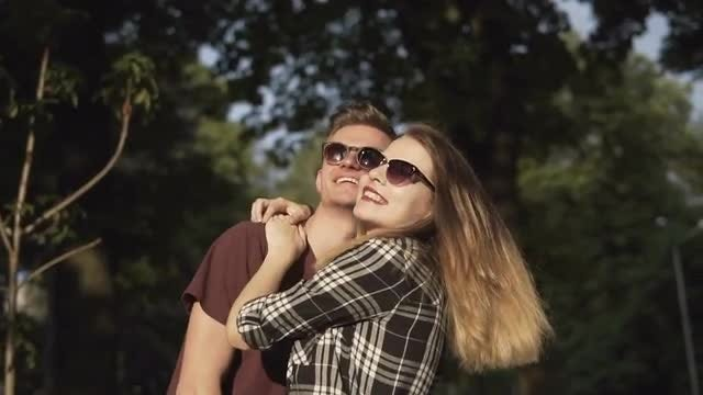 Young Couple In The Park: Stock Video