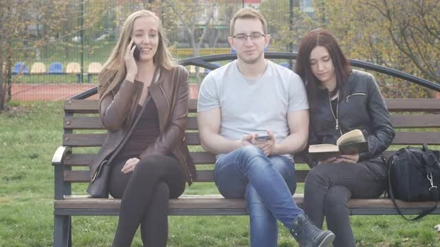 Young Friends Relaxing In Park: Stock Video