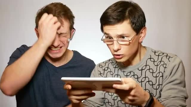 Men Frustrated By Computer Game: Stock Video