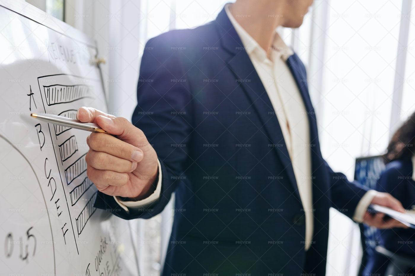 Entrepreneur Pointing On Diagram: Stock Photos
