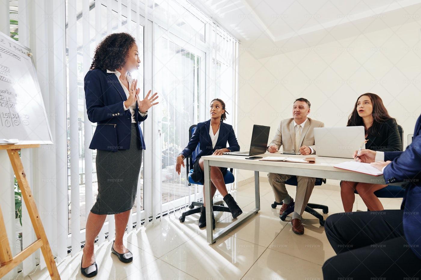 Female Entrepreneur Answering Questions: Stock Photos
