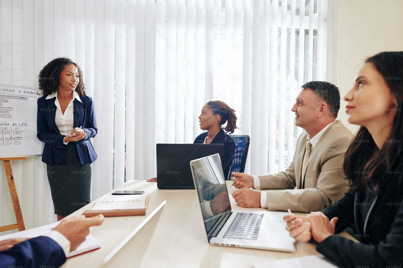 Business People Listening To Coworker: Stock Photos