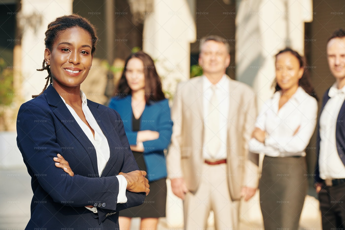Confident Businesswoman And Her Team: Stock Photos