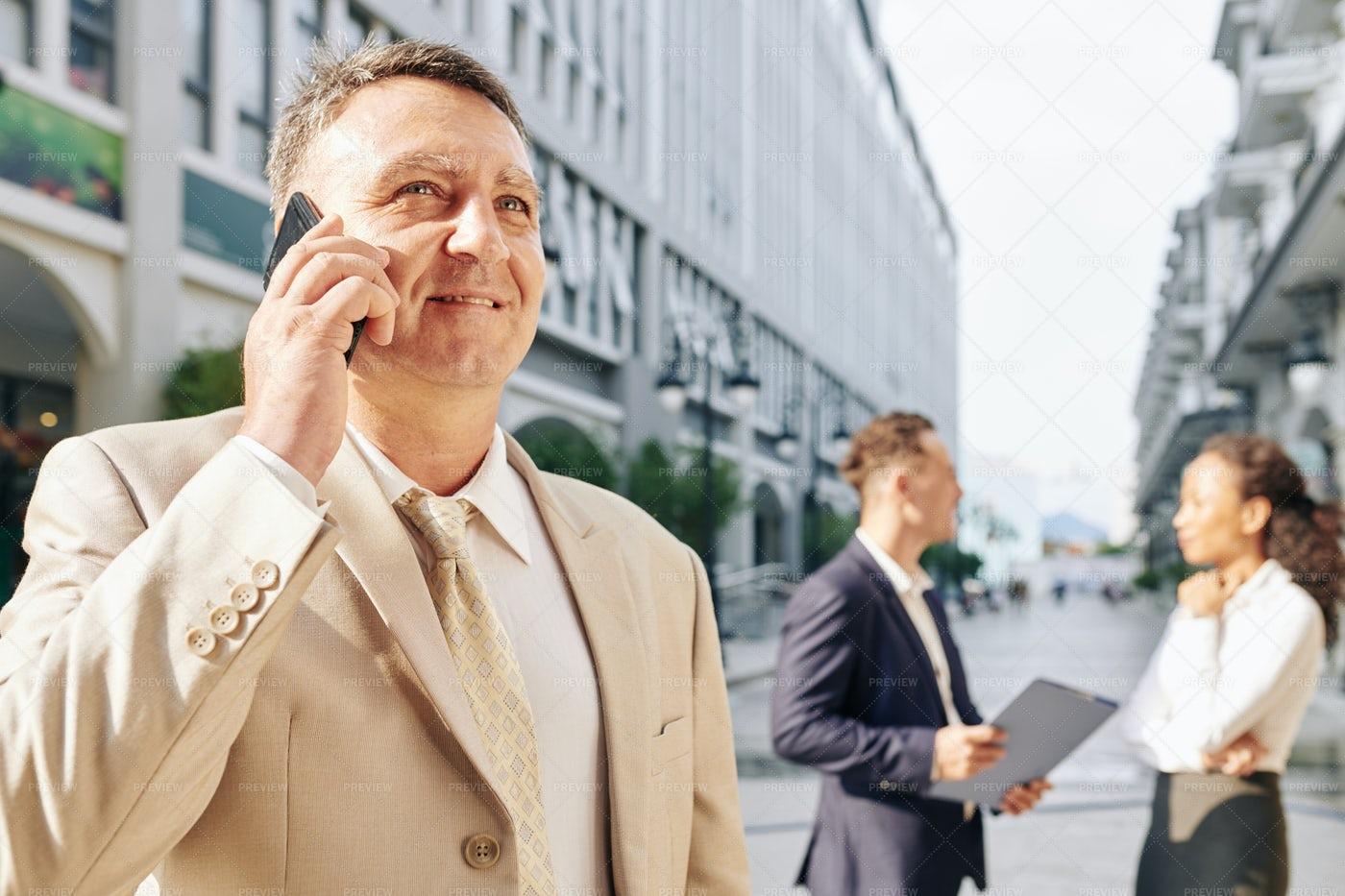 Mature Entrepreneur Talking On Phone: Stock Photos