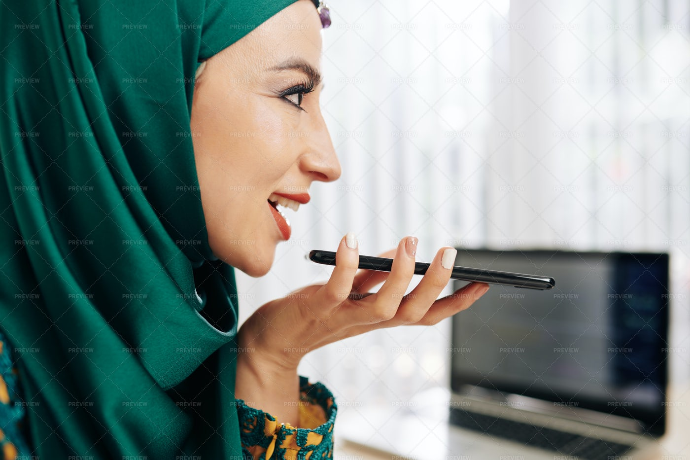 Businesswoman Recording Voice Message: Stock Photos