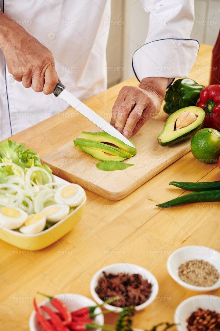 Cutting Avocado: Stock Photos
