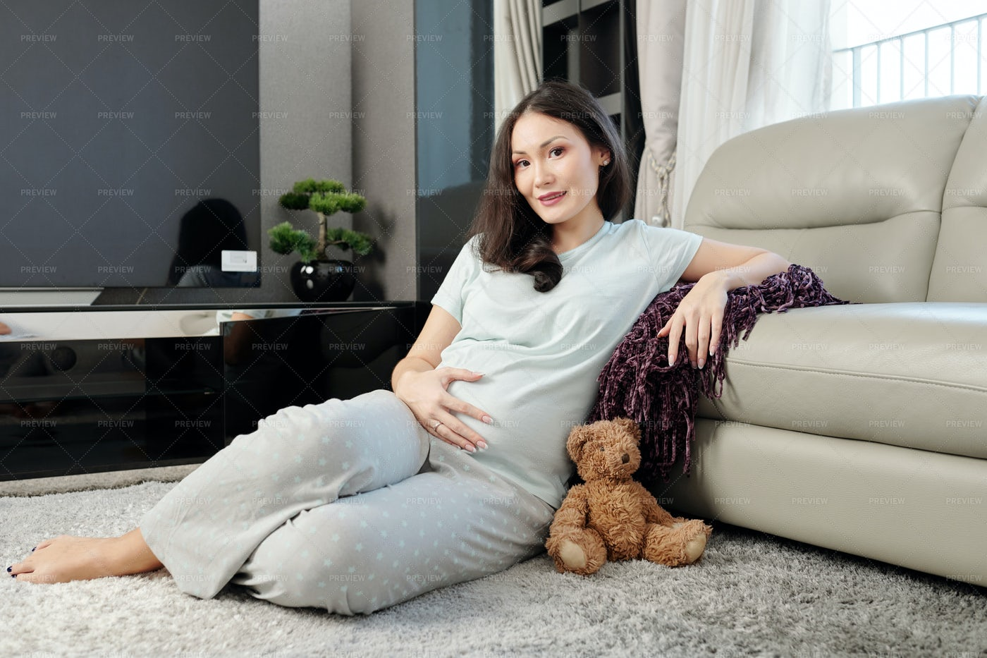 Pregnant Woman At Home: Stock Photos