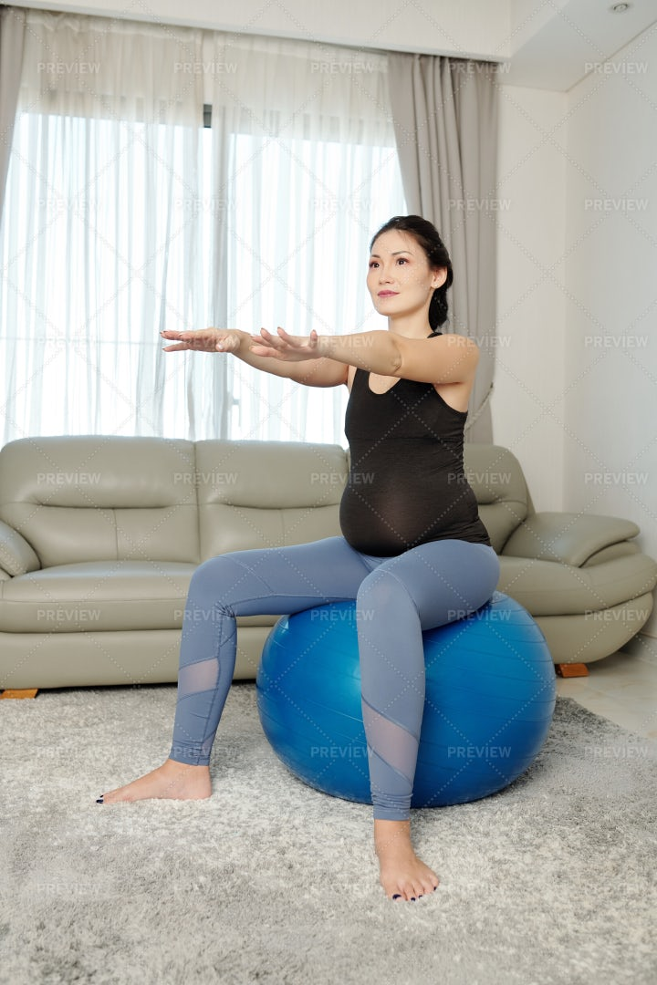 Pregnant Woman Doing Execises: Stock Photos