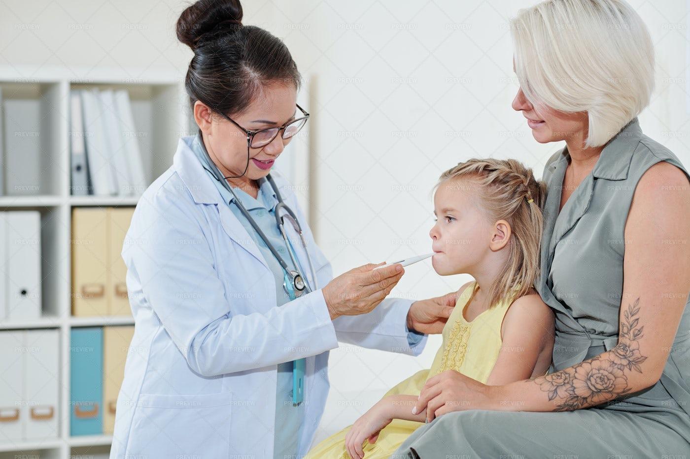 Pediatrician Checking Temperatire: Stock Photos