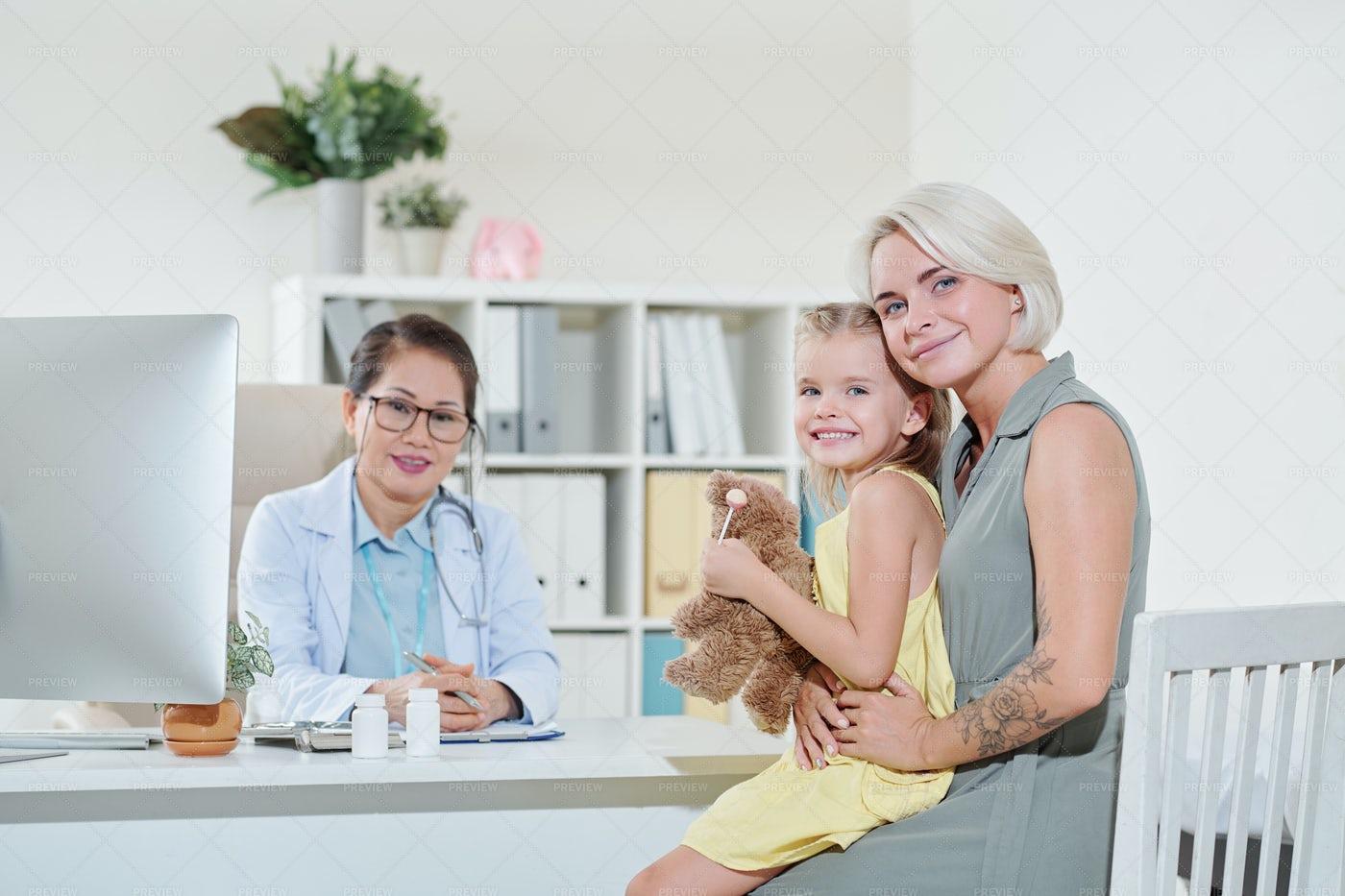 Mom And Daughter Visiting A Pediatrician: Stock Photos