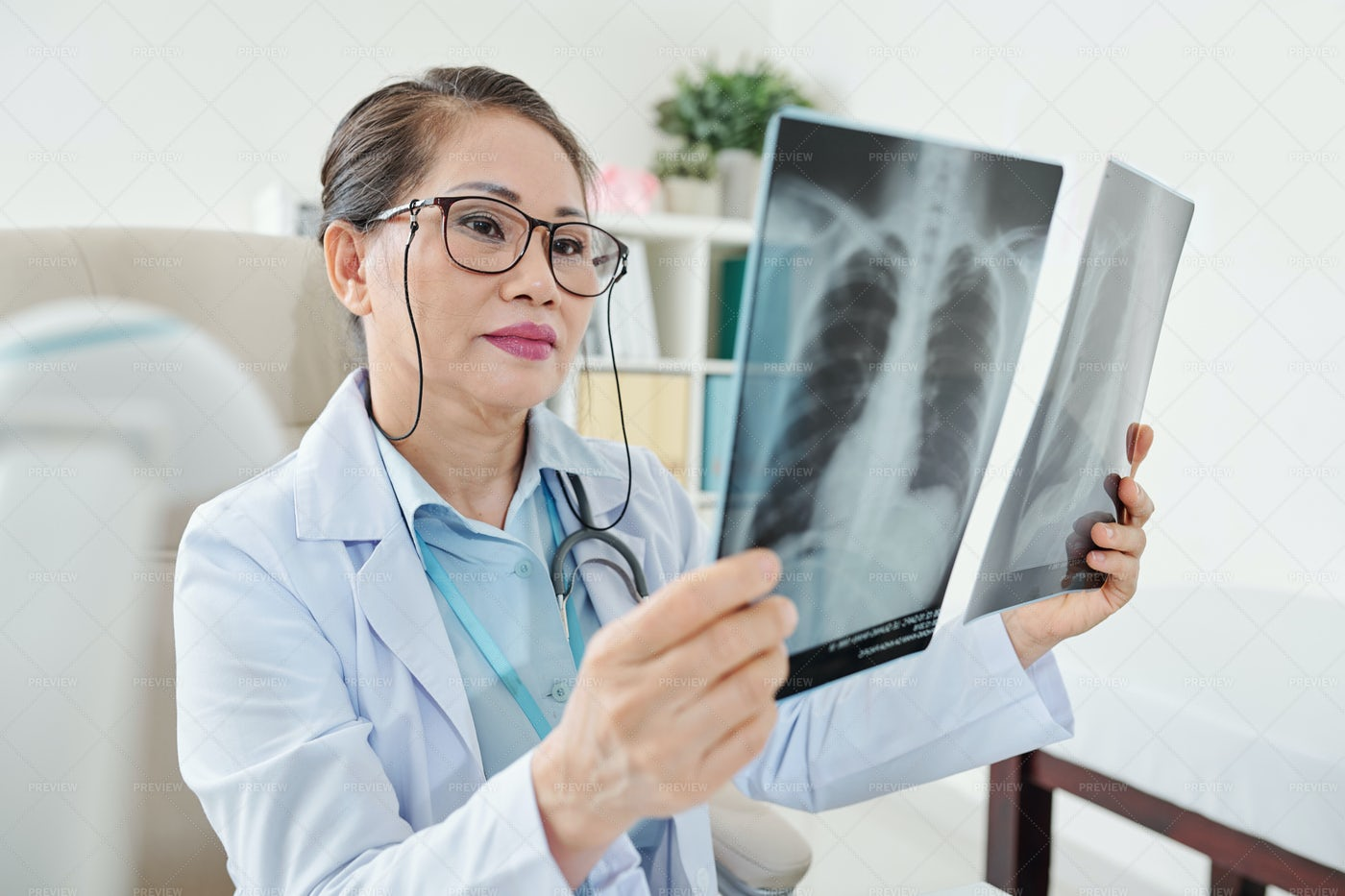 Doctor Looking At Chest X-rays: Stock Photos