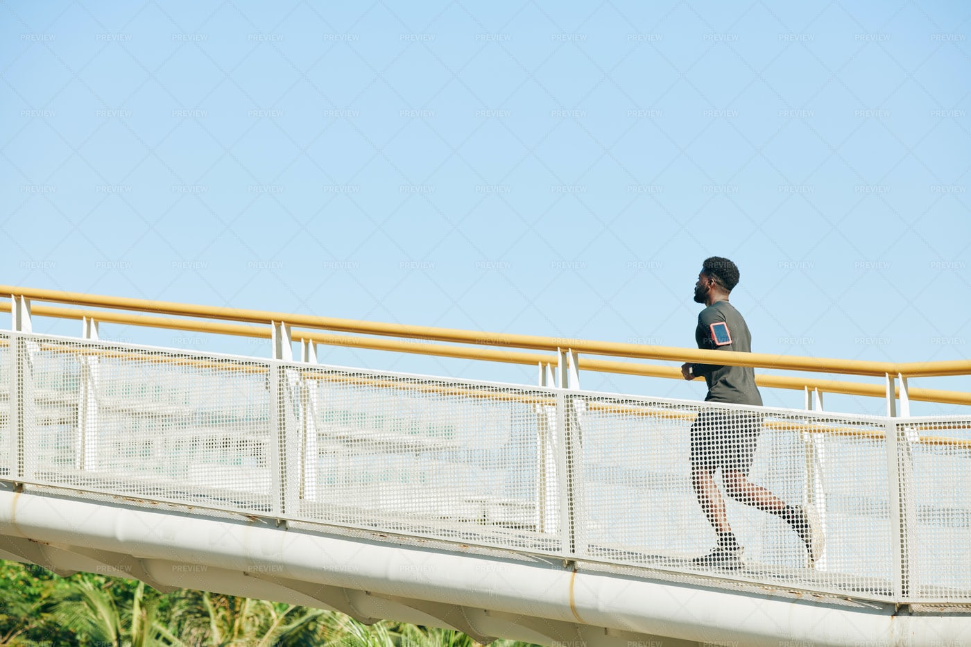 Man Running Along The Bridge: Stock Photos