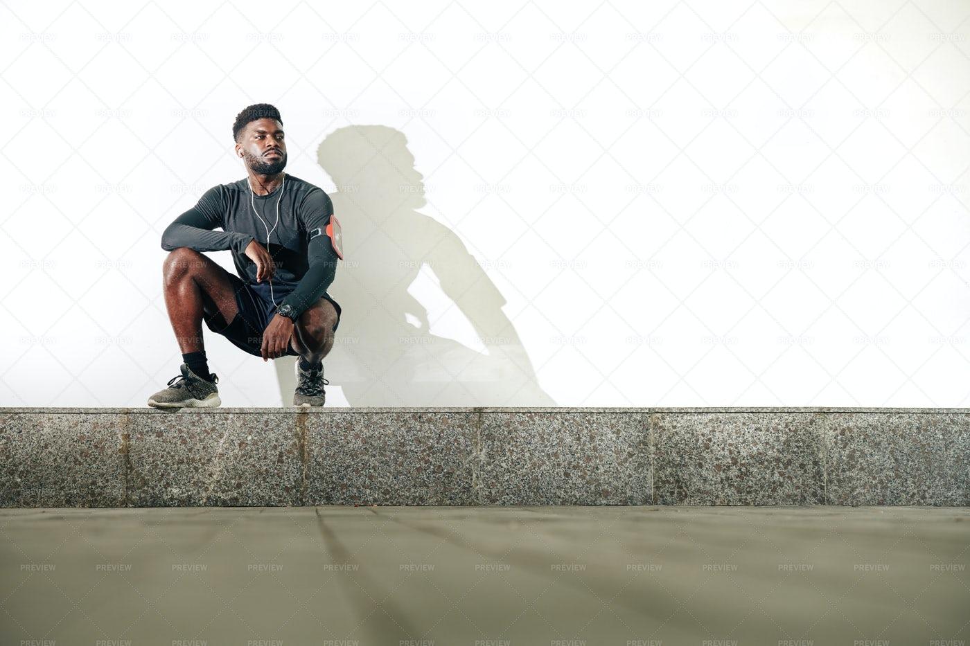 Sportsman Sitting On A Curb: Stock Photos