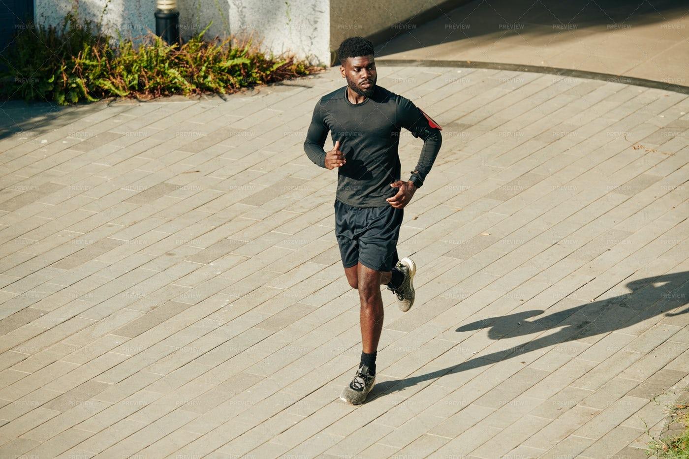 Man Running Outdoors: Stock Photos
