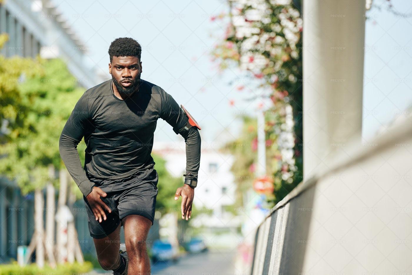 Man Running In The Street: Stock Photos