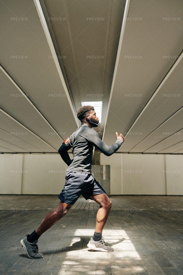 Man Running Through Tunnel: Stock Photos