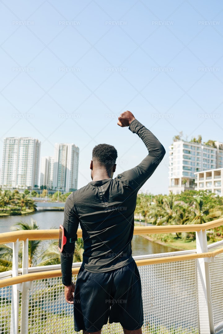 Sportsman Looking At City: Stock Photos