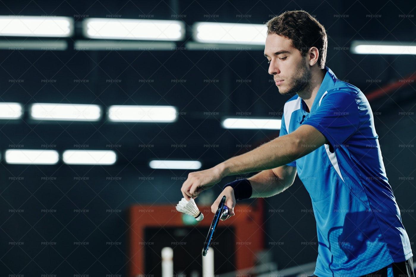 Badminton Player Serving Shuttlecock: Stock Photos