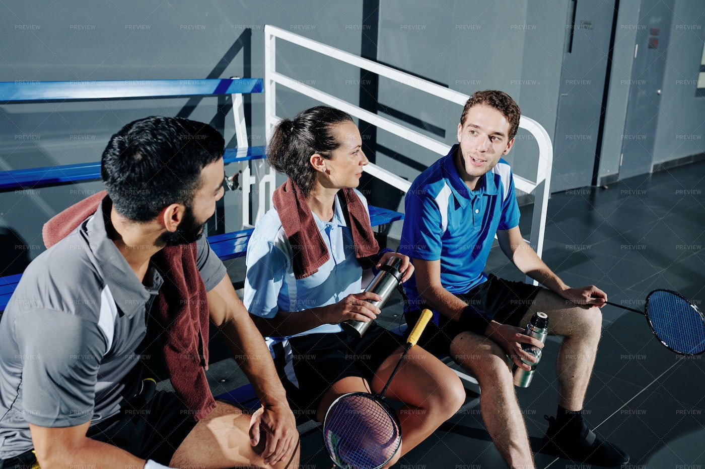 Badminton Players Resting On Bench: Stock Photos