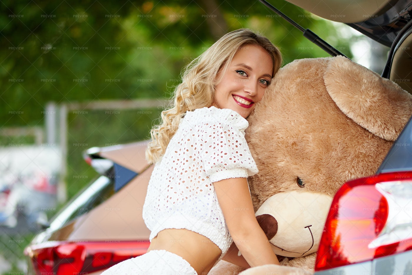 Hugging A Teddy Bear: Stock Photos