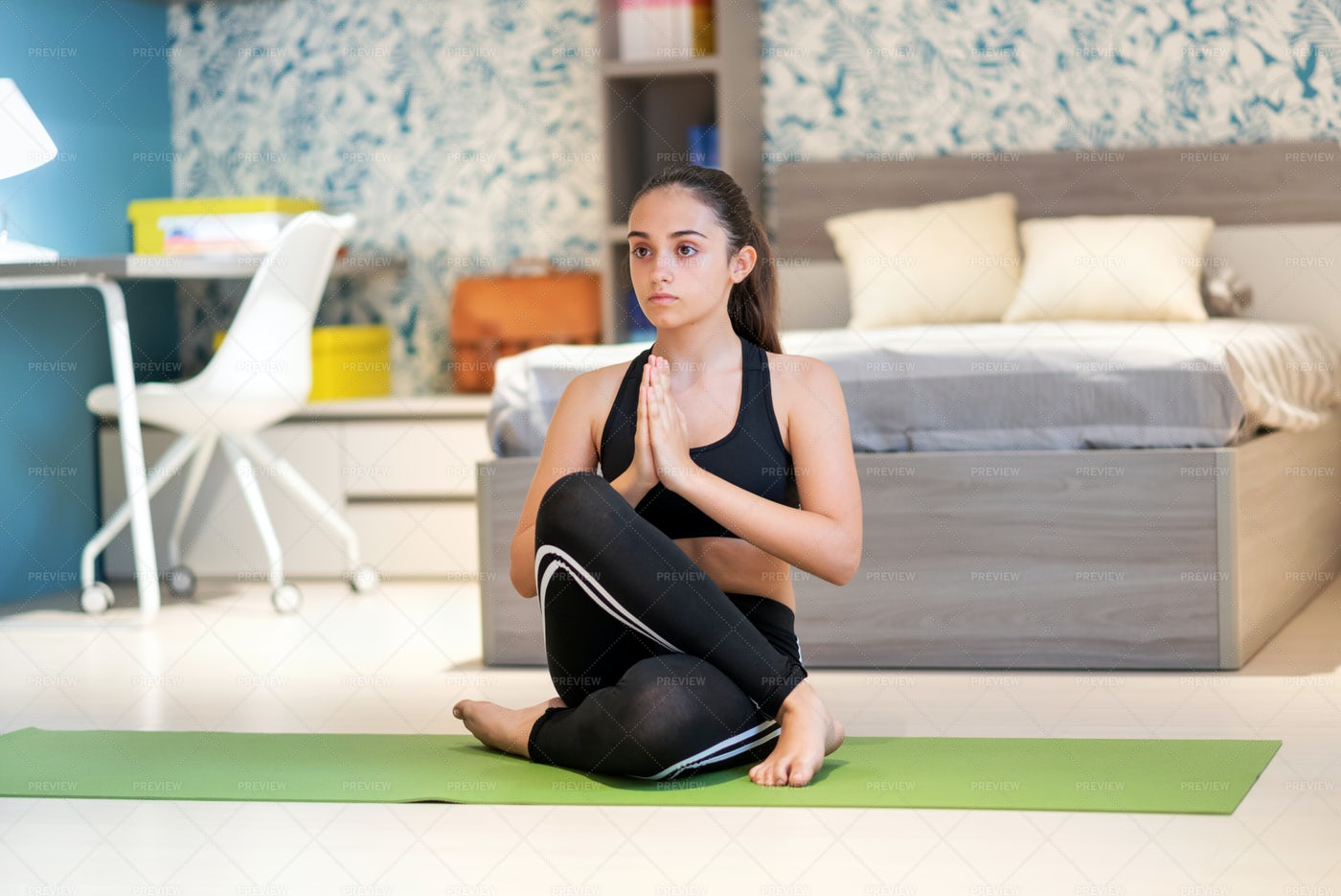 Focused Teen Practicing Yoga: Stock Photos