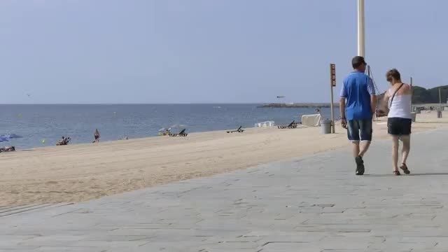 People Walking By The Beach: Stock Video