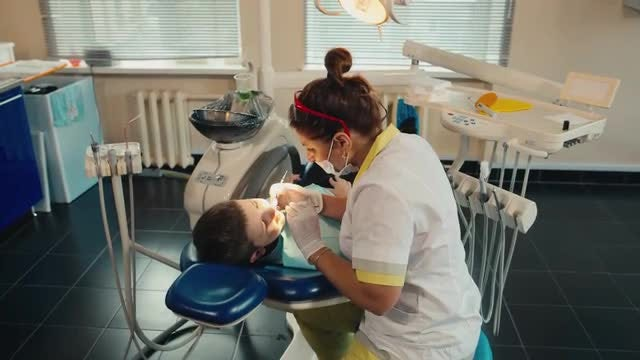 Young Boy Receiving Dental Treatment: Stock Video