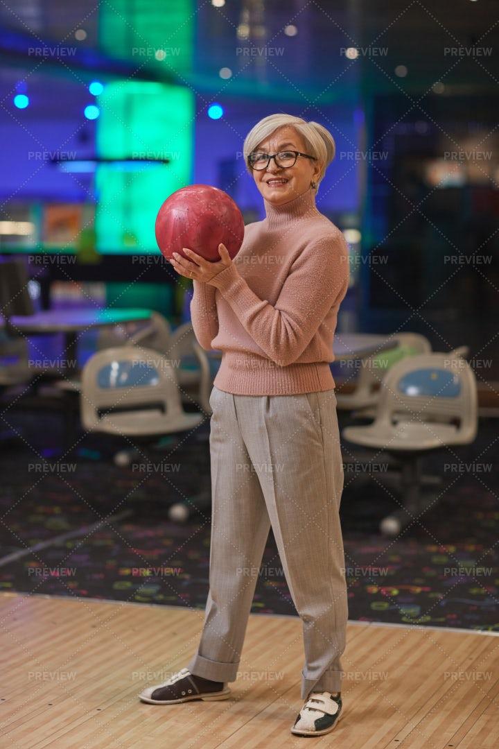 Senior Woman Hold Bowling Ball: Stock Photos