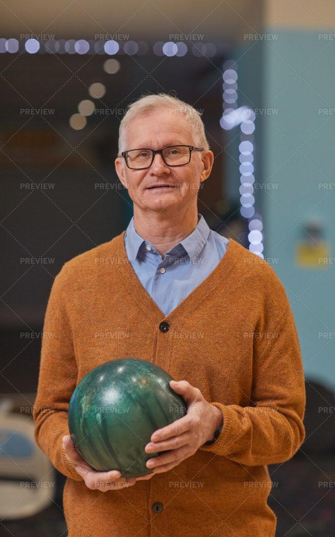 Senior Man Holding Bowling Ball: Stock Photos