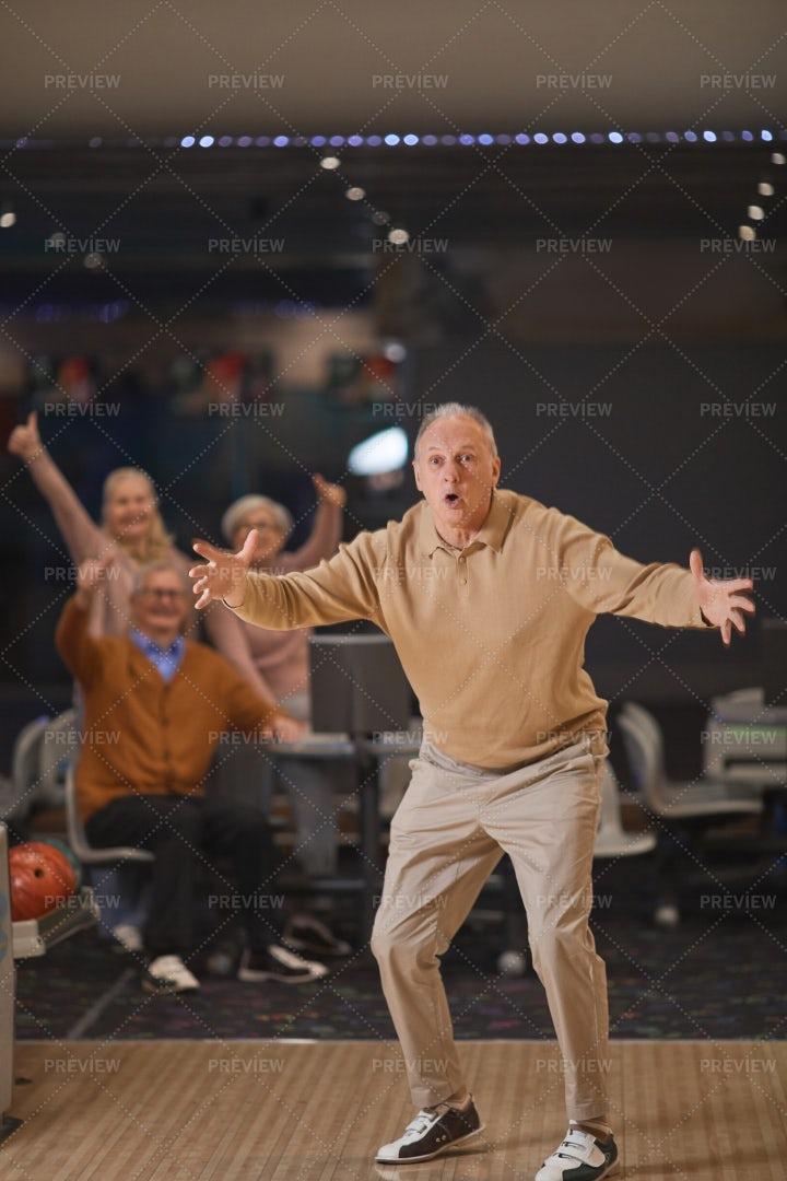 Emotional Senior Man Play Bowling: Stock Photos
