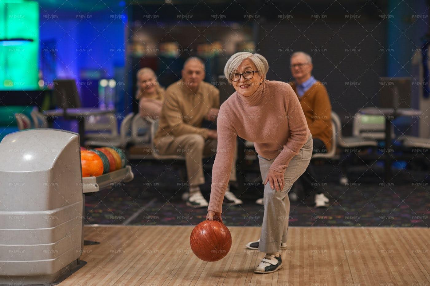 Senior Woman Playing Bowling: Stock Photos