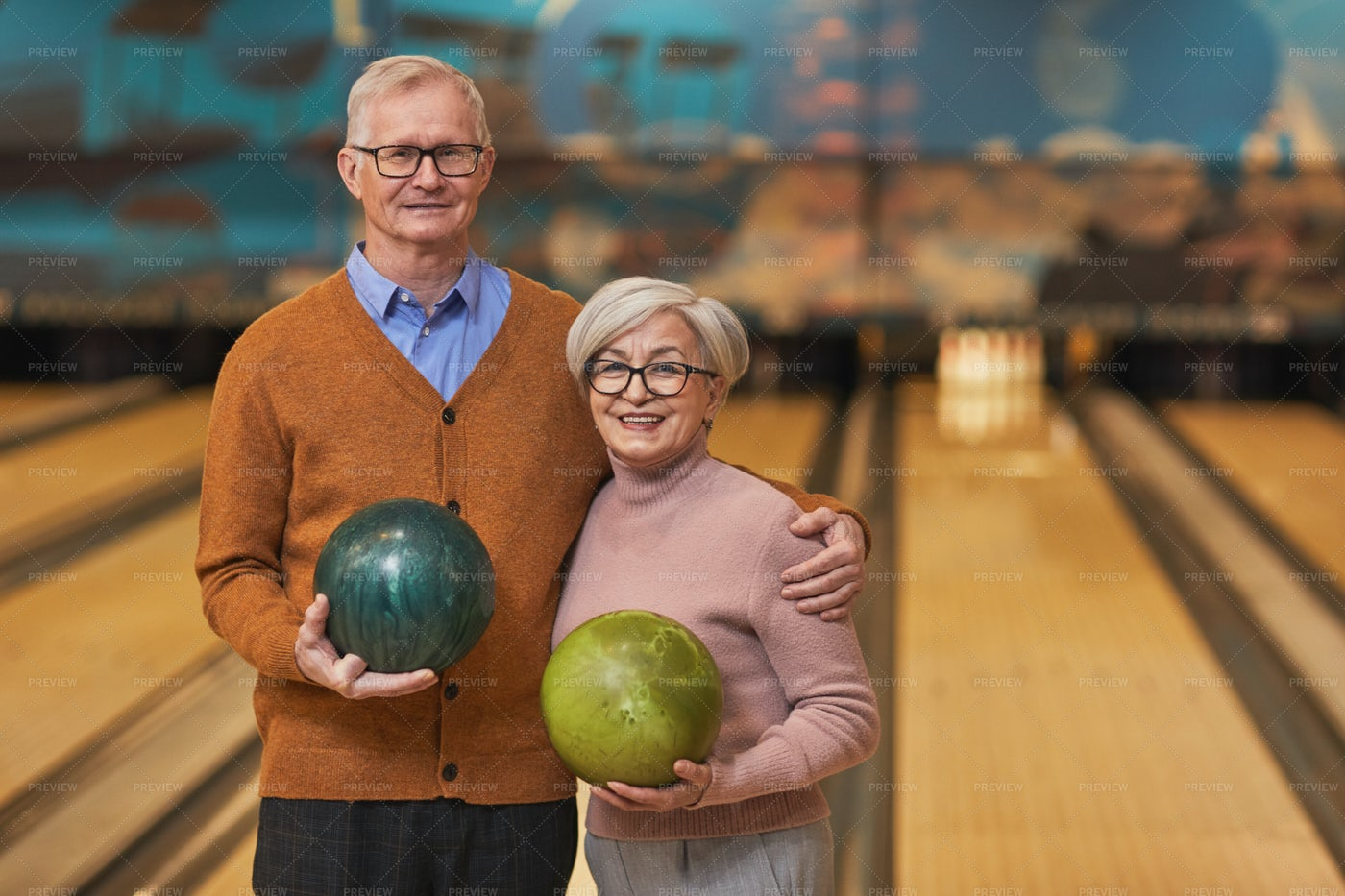 Senior Couple Posing At Bowling: Stock Photos