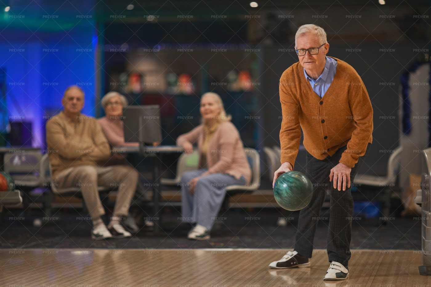 Senior Man Playing Bowling With Friends: Stock Photos