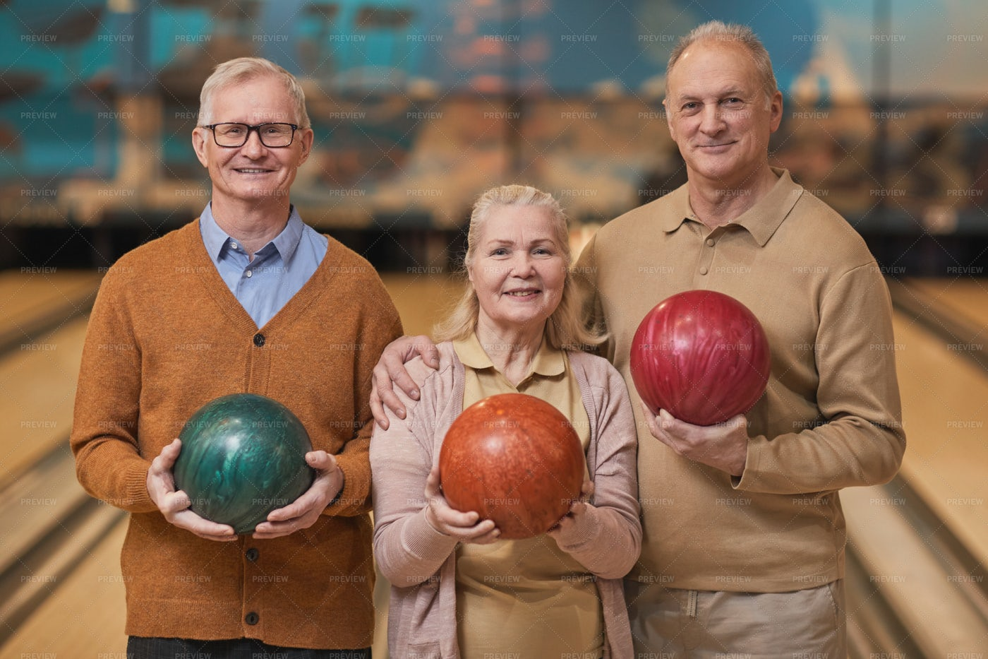 Senior Posing With Bowling Balls: Stock Photos