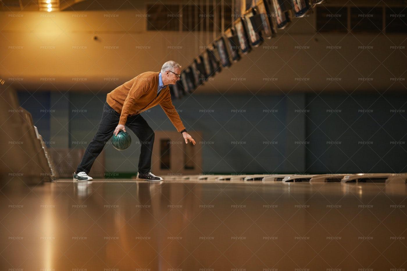 Elderly Man Playing Bowling: Stock Photos