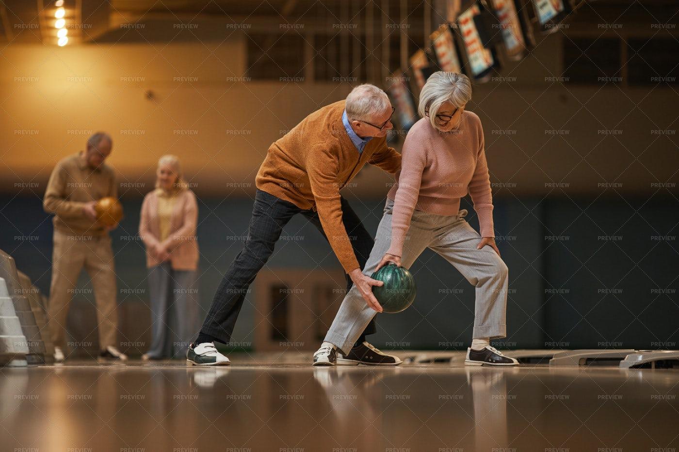 Active Senior Playing Bowling: Stock Photos