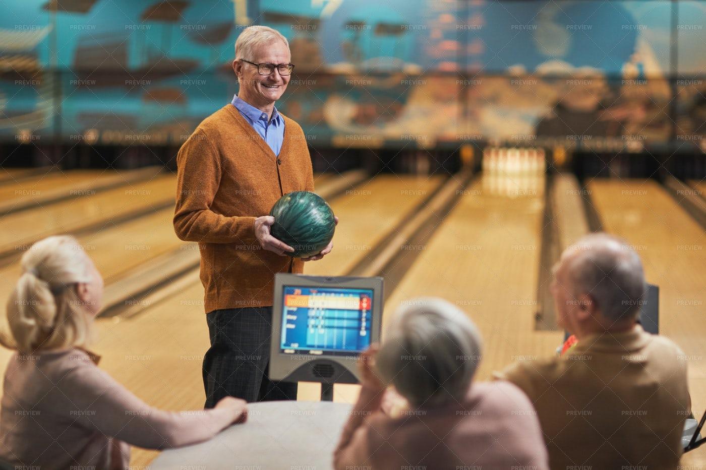 Senior Friends Enjoying Bowling: Stock Photos